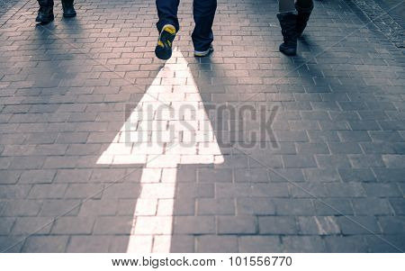 White Arrow Straight On Pavement Walking Street With Walking People Purple Vintage Tone