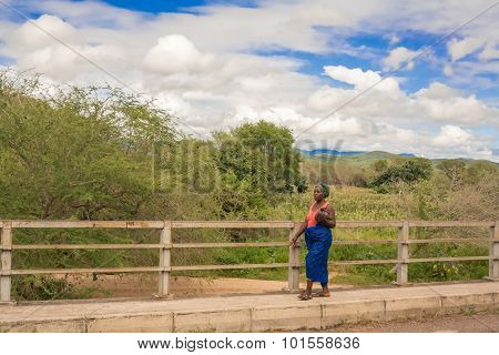 Woman At Sabi River Bridge, Malawi