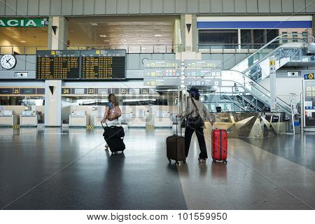 VALENCIA, SPAIN - SEPTEMBER 13, 2015: Airline passengers inside the Valencia Airport. About 4.59 million passengers passed through the airport in 2014.
