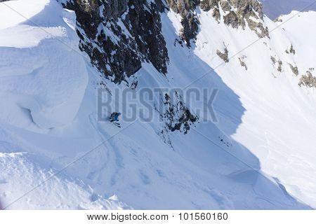 Skier in deep powder, extreme winter freeride