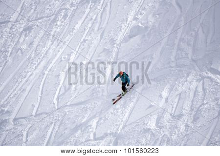 Extreme ski freeride, tracks on a slope. Skier in deep powder