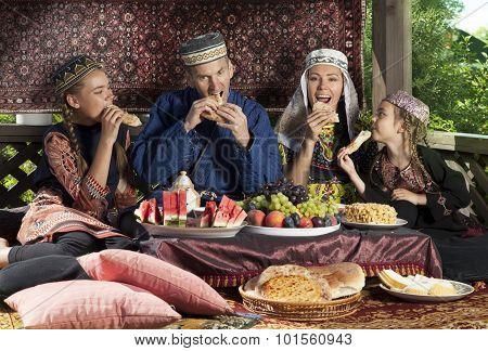 Uzbek Family Have Breakfast With Flat Cakes
