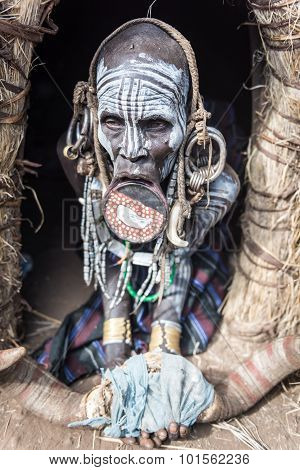 Old Mursi Woman In Her Hut