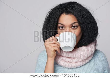 Smiling winter woman with cup of coffee