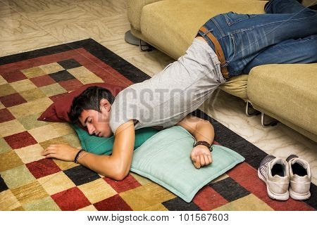 Drunk Man Resting On Couch With Head On The Floor