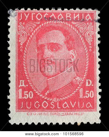 YUGOSLAVIA - CIRCA 1932: Stamp printed in Yugoslavia shows portrait king Alexander I (1888-1934), from series King Alexander I, circa 1932
