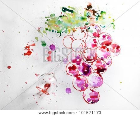 Grapes painted with wine and watercolors and wineglass of spilled wine on paper background