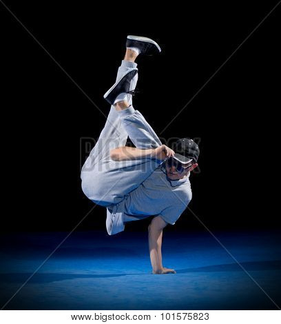 Breakdancer training on dark background