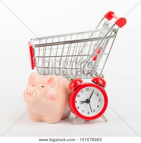 Piggy bank, clock and shopping cart