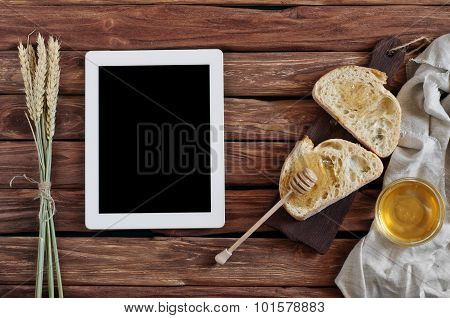 Two Pieces Of Fresh Bread With Homemade Honey On A Wooden Table Closeup