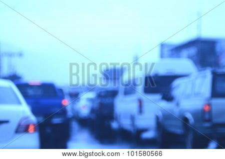 Blur Traffic Road In Rainy Day Abstract Background.