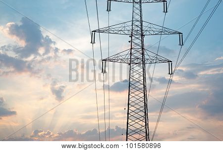 Electric poles on blue sky with clouds