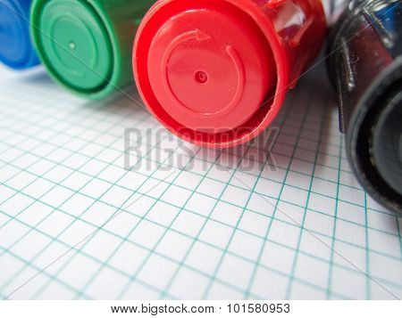 four markers and math copybook