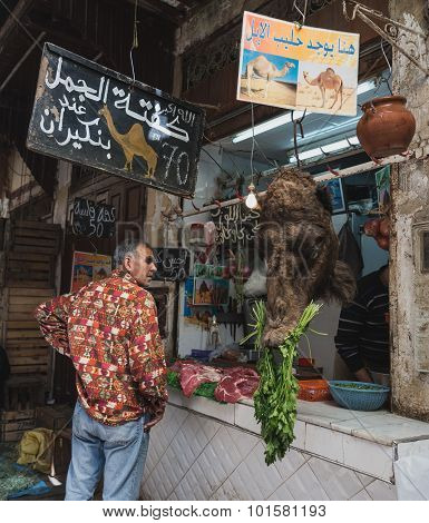 The Moroccan Man Look At Camel Head In The Market