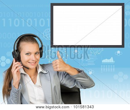 Businesslady in chair and earphones
