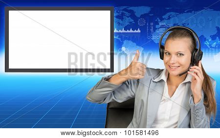 Smiling businesslady in chair and earphones
