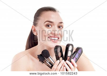 Beautiful Smiling Woman With Set Of Brushes And Palette Of Colorful Shadows For Makeup