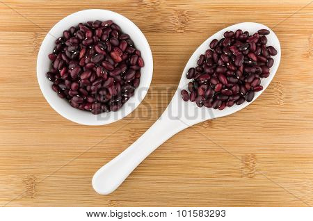 Raw Red Beans In Glass Bowl And Plastic Spoon