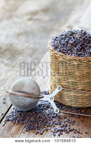 Lavender Herbal Tea In Basket And Tea Infuser. Selective Focus.