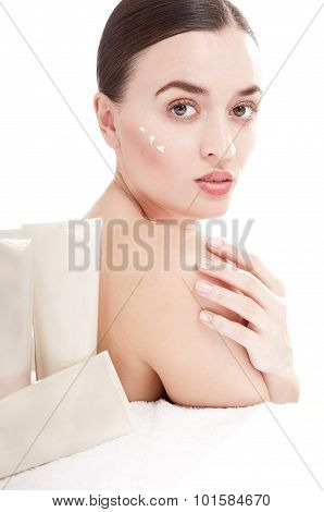 Young Woman With  A Well-groomed Skin Applying Beauty Product