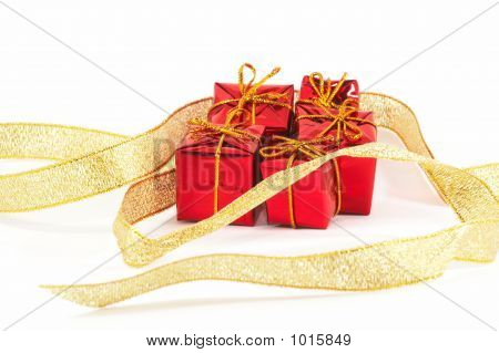 Christmas Presents Wrapped By Garland On White Background