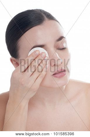 Woman With Well-groomed Complexion  Holds Cotton Swab Near Her Face