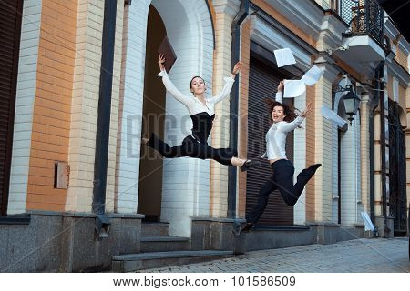 Girls Happily Jump Up And Throw Papers.