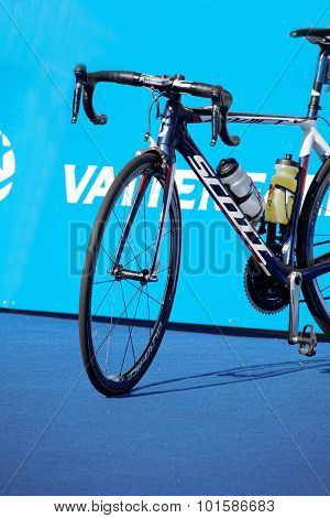 Triathlete Bicycle And Blue Background