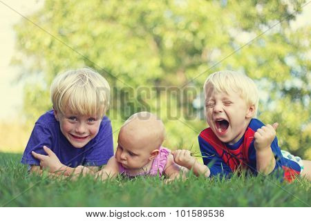 Three Silly Children Relaxing Outside