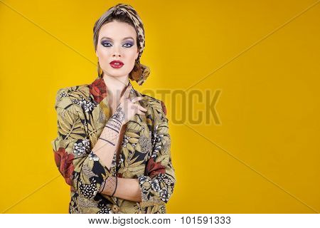 beautiful woman in oriental style with mehendi in hijab. on yellow background .copy space