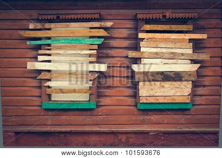 The old vintage boarded-up windows