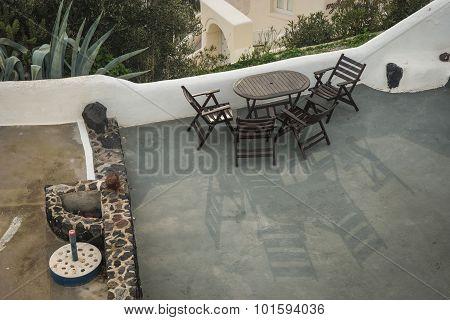 Table And Chairs On The Balcony, Oia, Santorini, Greece