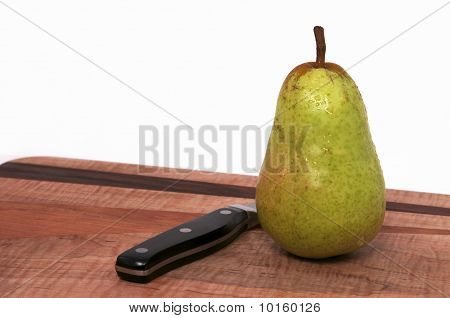 Single Pear on Cutting Board