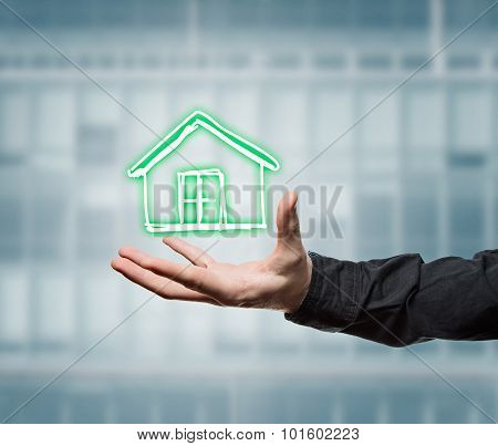 Businessman Holding A Virtual House