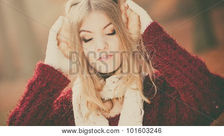 Portrait Of Pretty Relaxed Woman In Earmuffs.