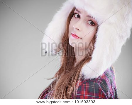 Young Woman In Winter Clothing Fur Cap