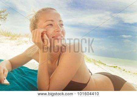 Happy woman in bikini on the beach.