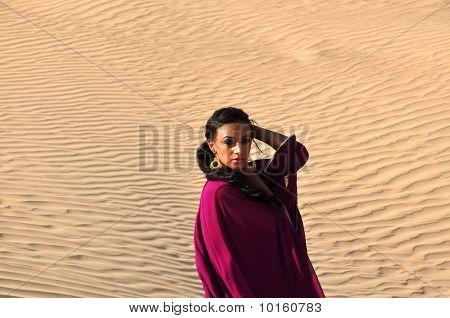 Beautiful Brunette Woman Posing In Arabic Desert