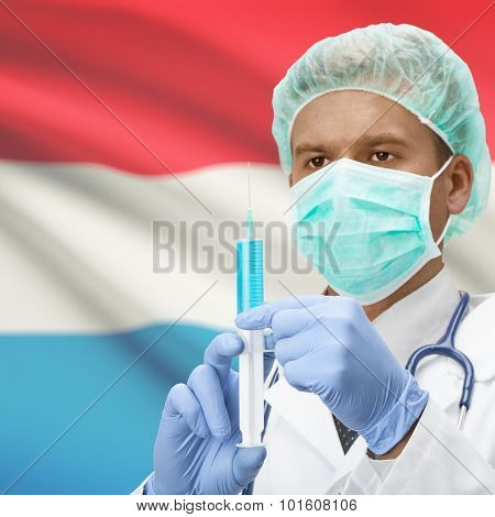 Doctor With Syringe In Hands And Flag On Background Series - Luxembourg