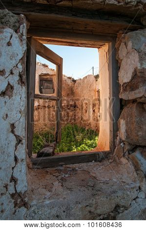 Old Opened Window Of A Destroyed House, Elafonisos, Greece