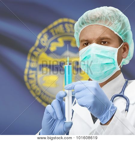 Doctor With Syringe In Hands And Us States Flags On Background Series - Nebraska