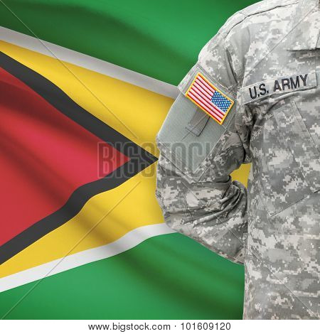 American Soldier With Flag On Background - Guyana