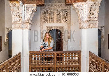MARRAKESH, MOROCCO, APRIL 16, 2015: Tourist posing in the Ben Youssef Madrasa
