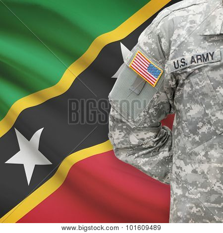 American Soldier With Flag On Background - Saint Kitts And Nevis