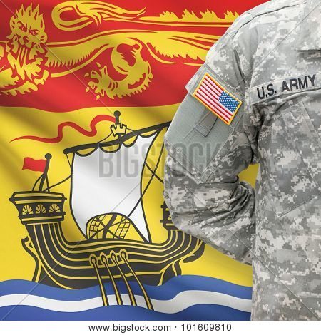 American Soldier With Canadian Province Flag On Background - New Brunswick