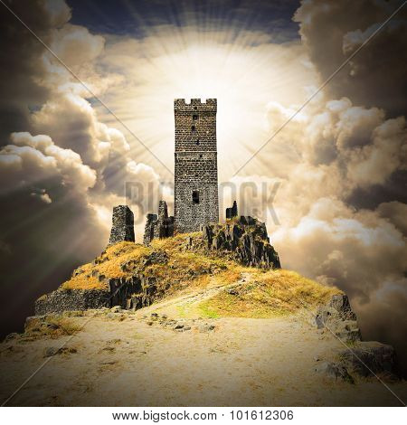 Romantic scenery with ruins of gothic castle on a cliff edge. Warm filtered picture.
