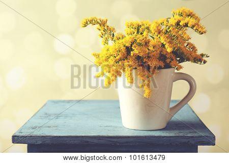 Beautiful mimosa flowers on light blurred background