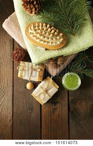 Handmade soap and cream with pine extract and spa treatments on wooden background