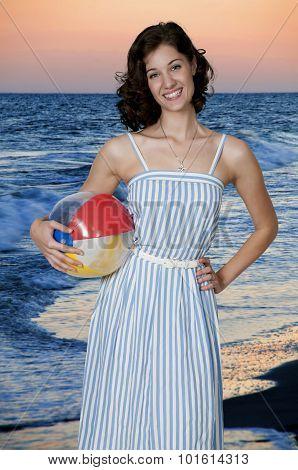 Woman Holding a Beach Ball