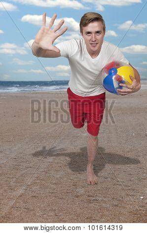 Man Holding Beach Ball